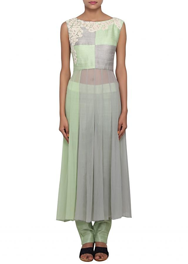 Grey and pistachio green straight fit flowy suit embellished with white thread work only on Kalki