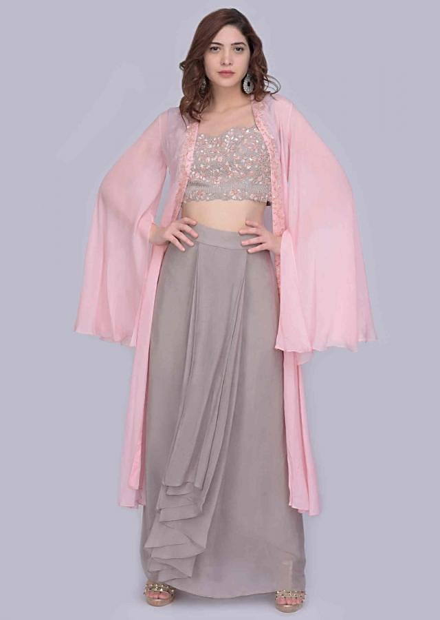 Grey cascading drape skirt with matching embellished crop top and contrasting pink jacket  only on Kalki