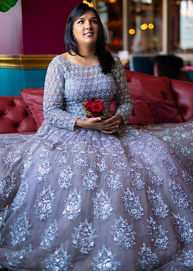 Grey flared net gown in silver embroidered butti online - Kalki fashion