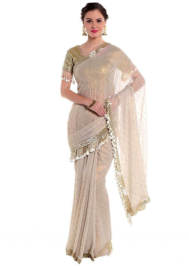 Grey georgette saree embellished with cut dana work  only on Kalki