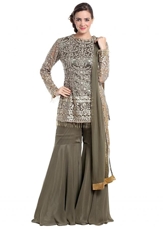 Grey net gharara suit with zari and sequinsonly on Kalki