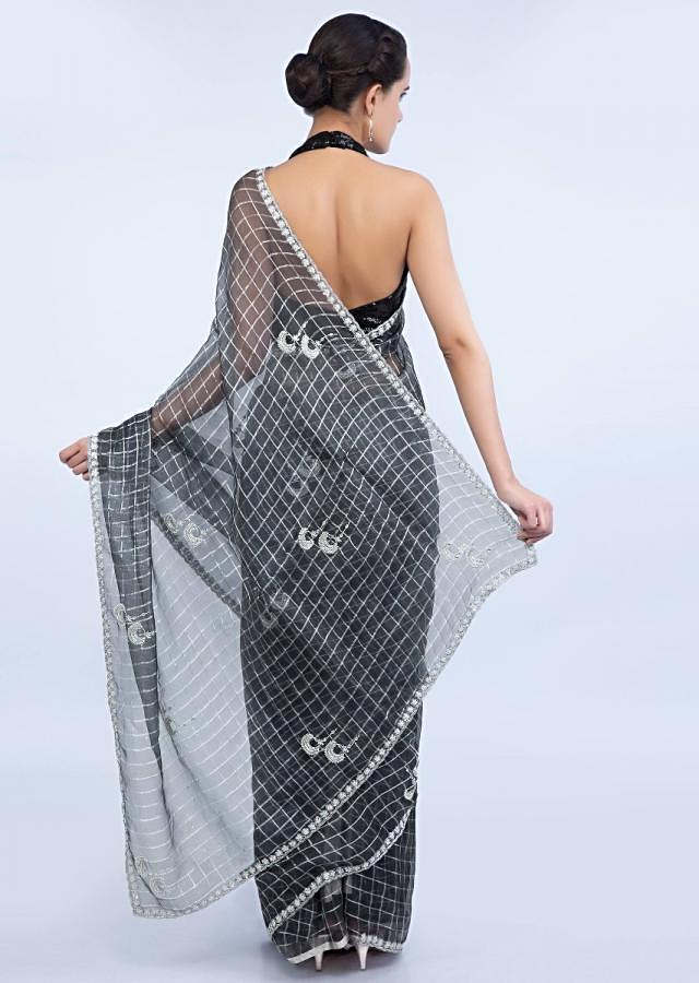 Grey organza checks saree with hand embroidered butti and border only on Kalki