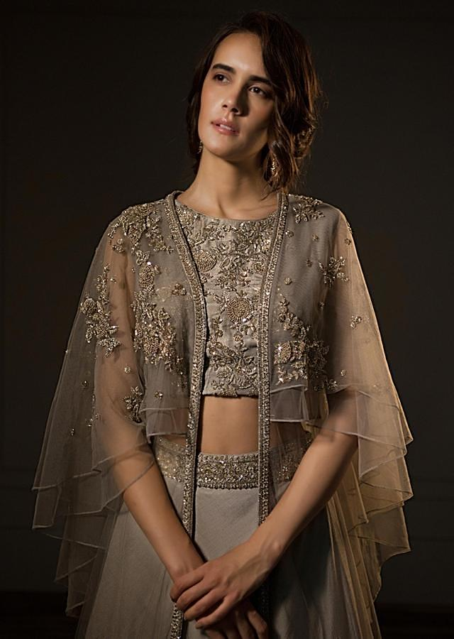 Grey organza lehenga and embroidered crop top with fancy cape jacket only on Kalki