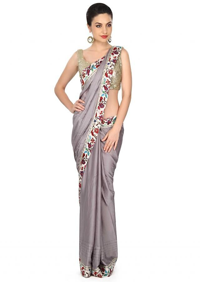 Grey saree adorn in pleats and floral border only on Kalki