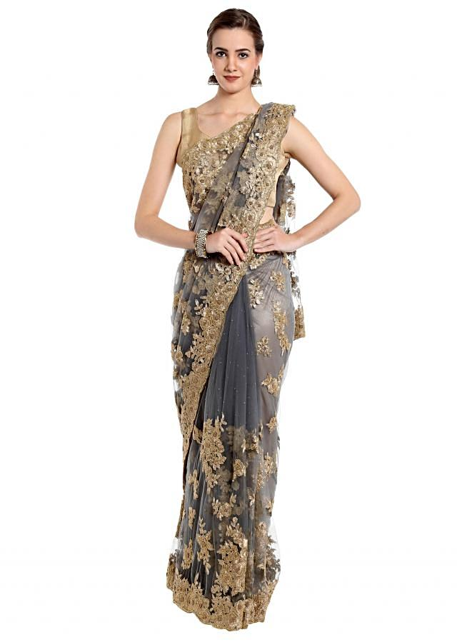 Grey saree embellished in zari and cut dana embroidery only on Kalki