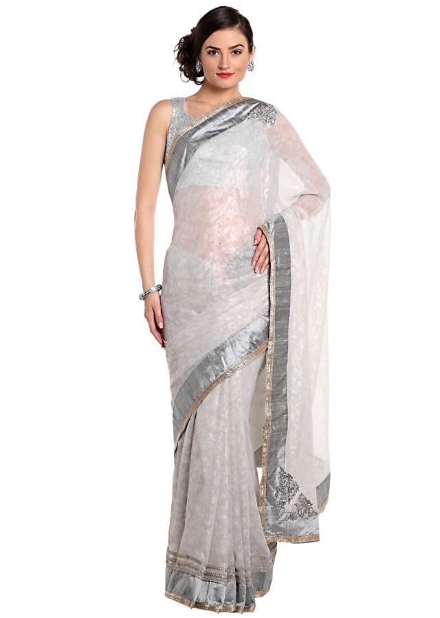 Grey saree in foil georgette with embroidered butti only on Kalki