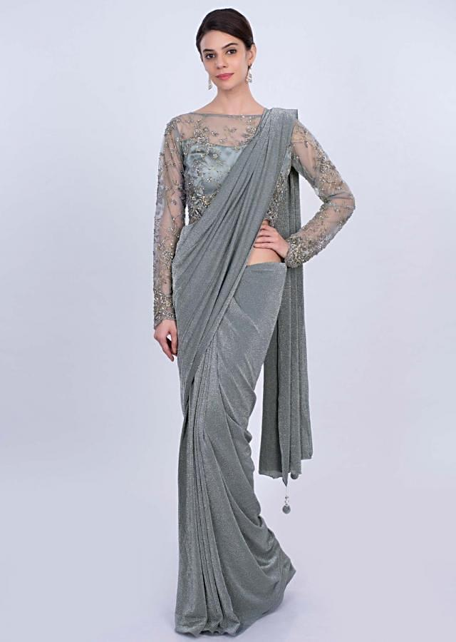 Grey shimmer lycra saree with matching net embroidered blouse only on Kalki