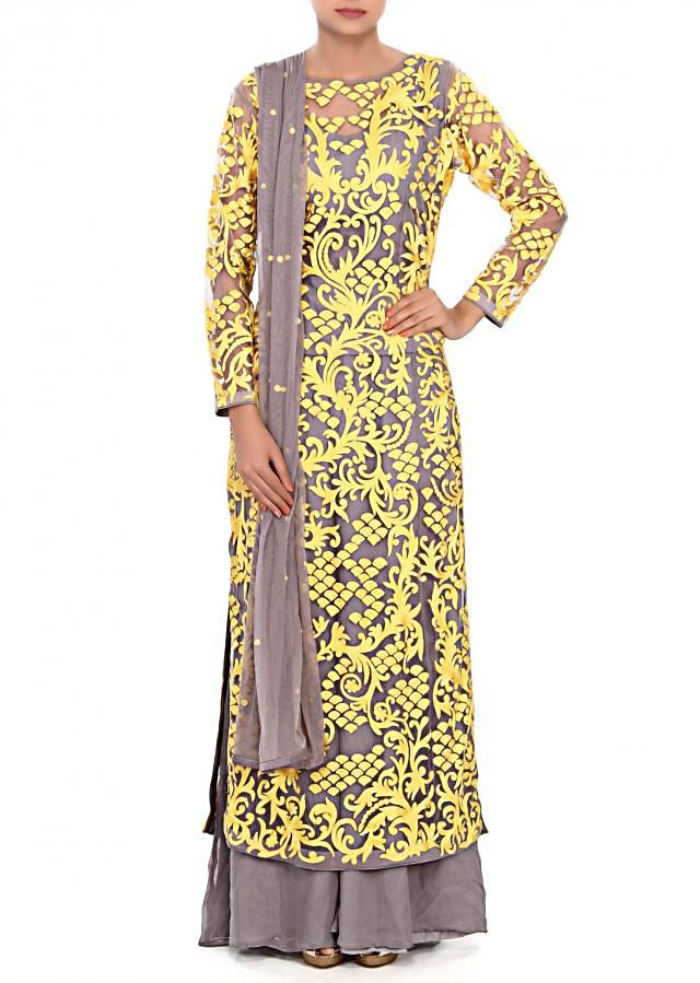 Grey straight suit enhanced in thread embroidery only on Kalki