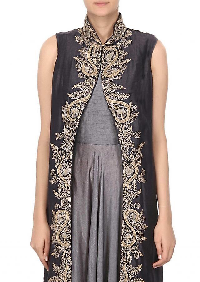 Grey suit matched with long embroidered jacket only on Kalki