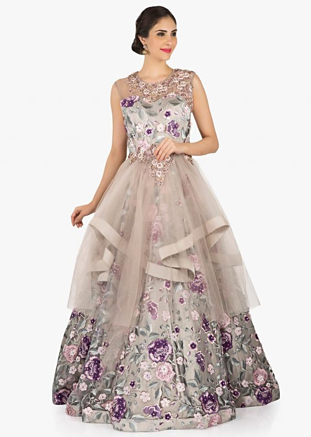 Grey and pink floral gown in net adorn in resham and zardosi work only on Kalki