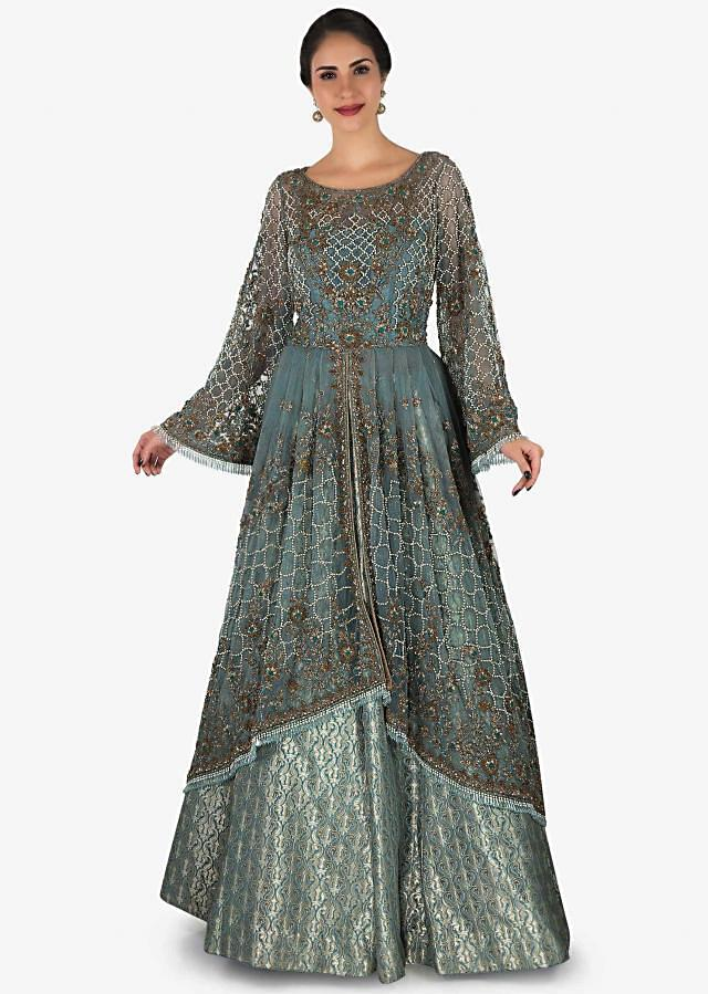 Grey brocade lehenga with high low embroidered top in moti and tassel work only on Kalki