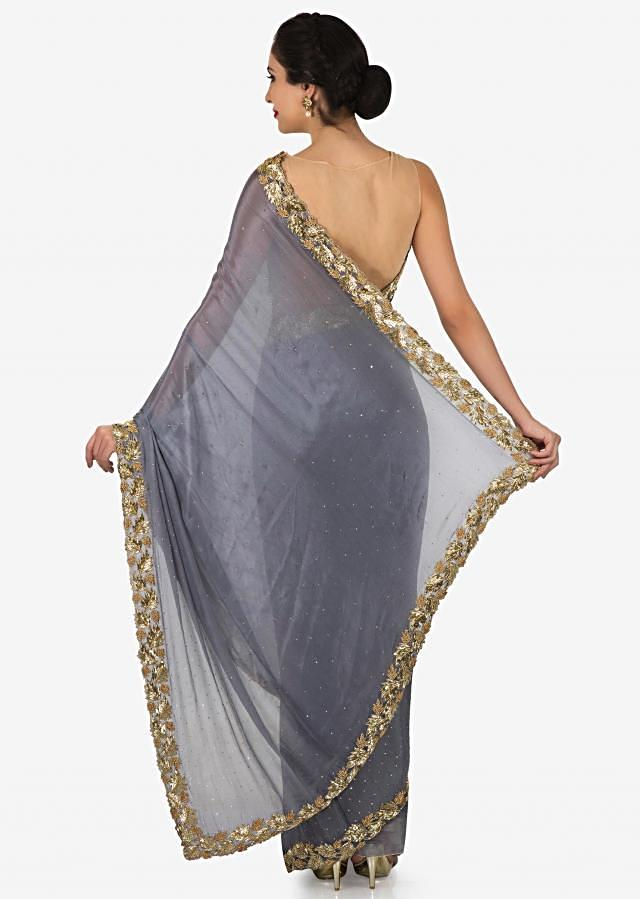 Grey georgette saree with unstitched blouse adorn in heavy cut dana work only on Kalki