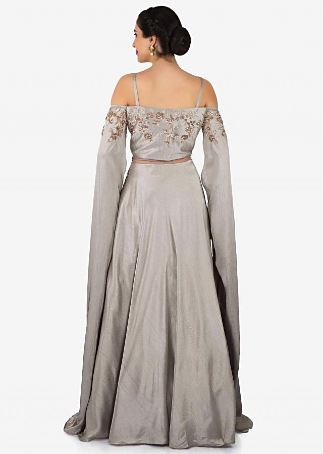 Grey gown in taffeta silk with cold shoulder and long sleeve only on Kalki