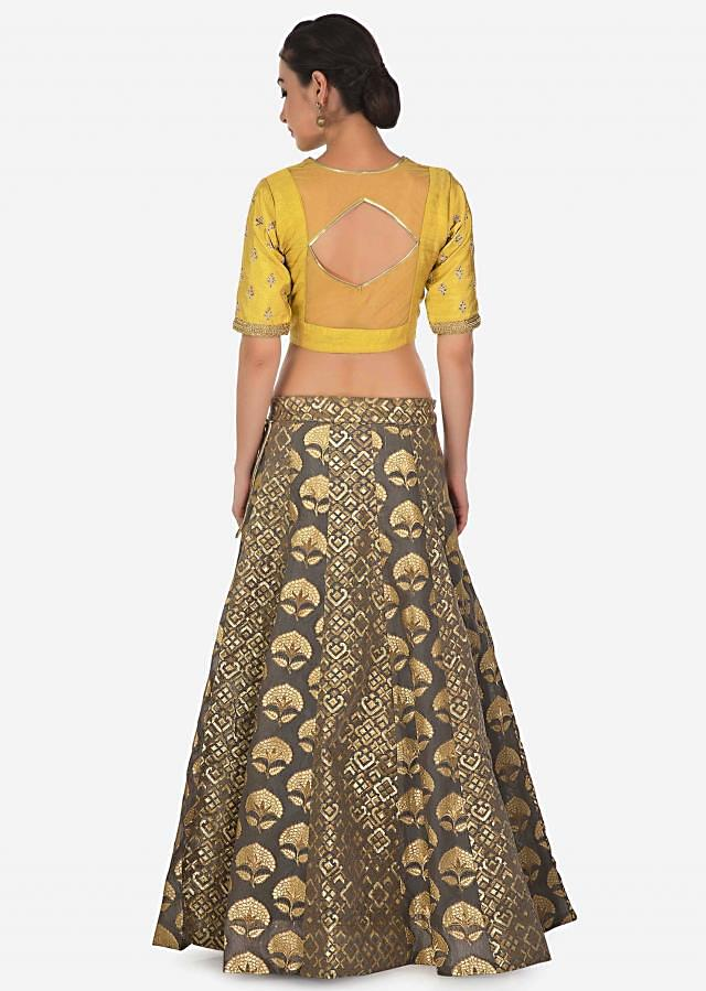 Grey lehenga in brocade silk with yellow raw silk embroidered blouse only on Kalki