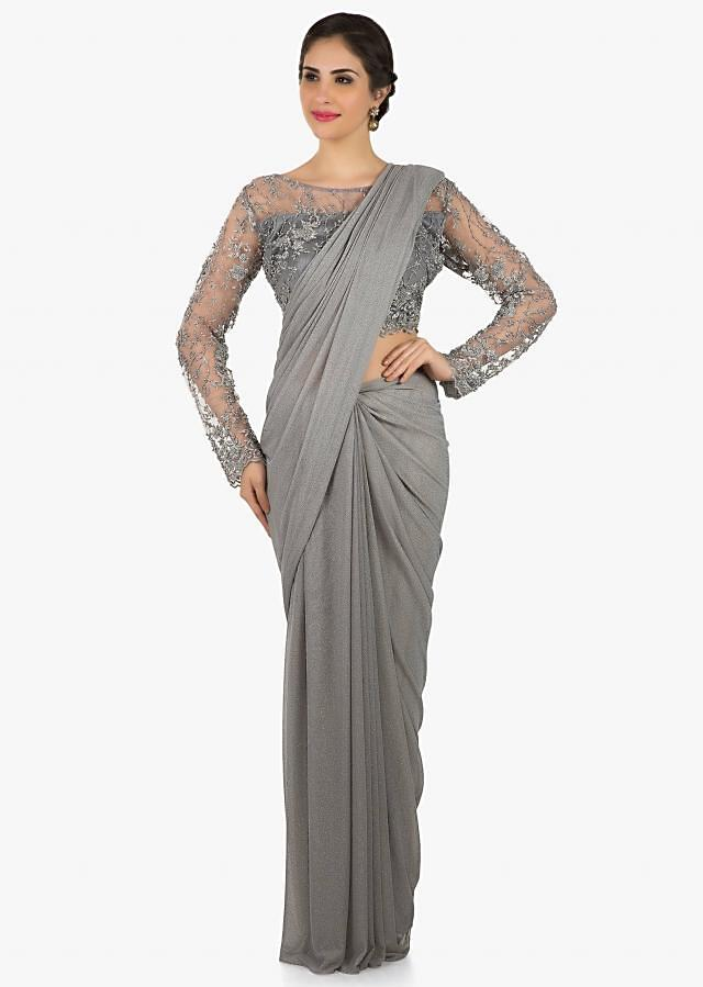 Grey lycra saree with stitched blouse adorn in kundan embroidery work only on Kalki