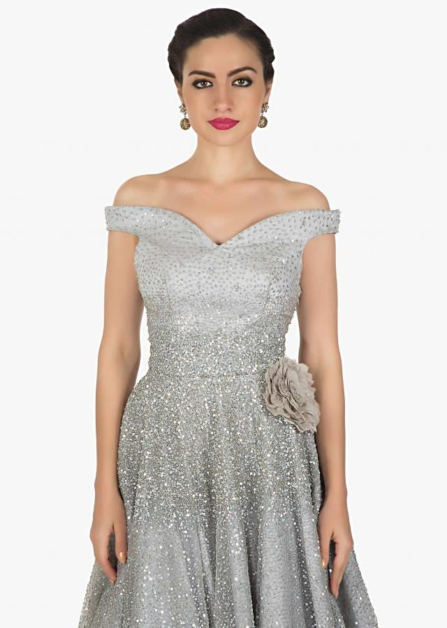 Grey off shoulder gown in sequin net highlighted in 3D flower embroidery only on Kalki