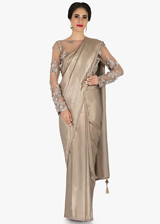 Grey saree in foil georgette with stitched 3D flowered embroidered blouse only on Kalki