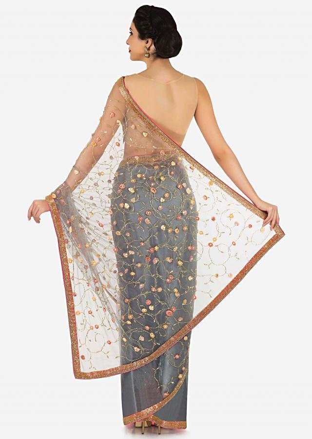 Grey saree in net adorn in 3D flower embroidery along with cut dana work only on Kalki