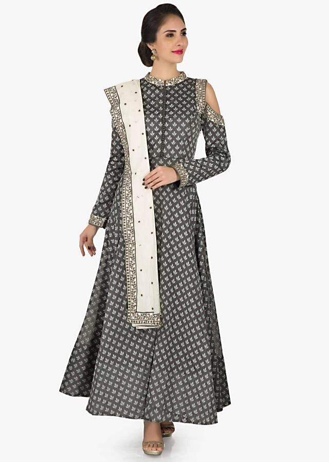 Grey silk suit beautified in resham embroidery work only on Kalki