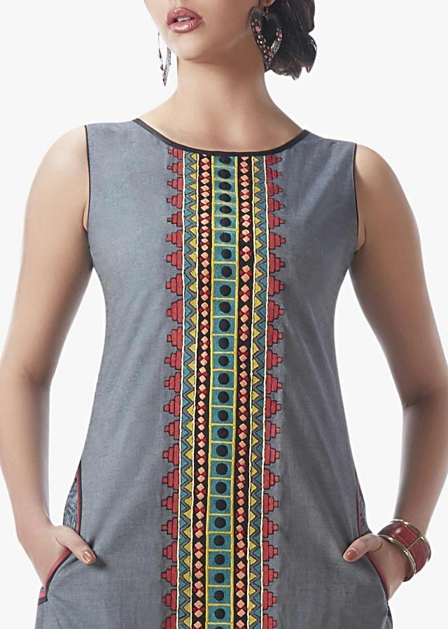 Grey straight cut suit beautified with multi colored resham patch work