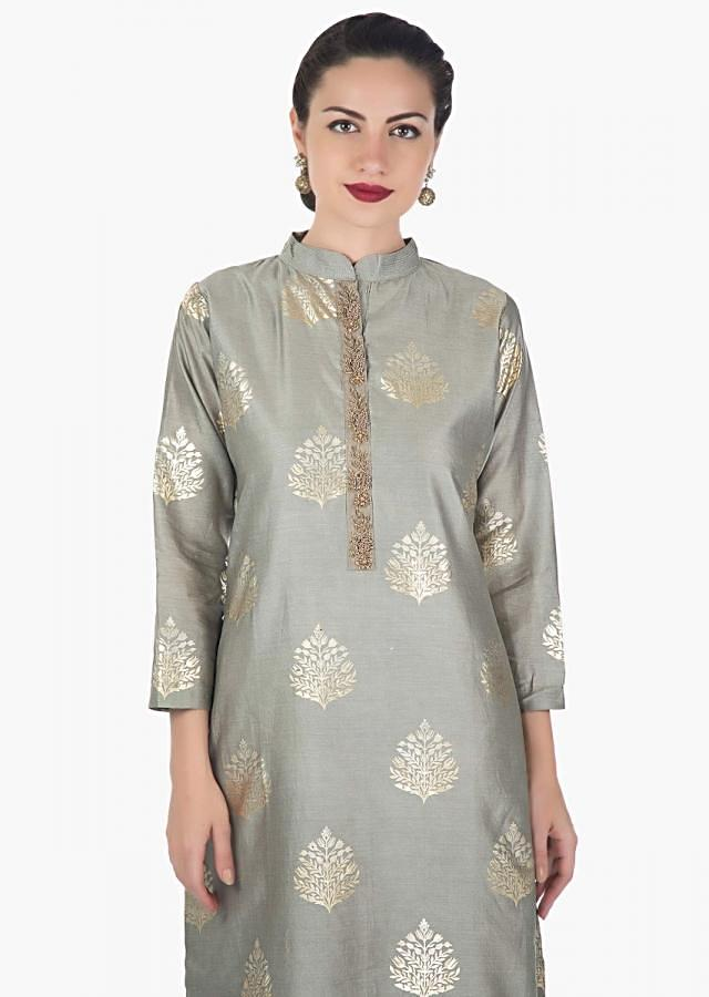 Grey straight suit adorn in foil print and zardosi embroidered placket only on Kalki