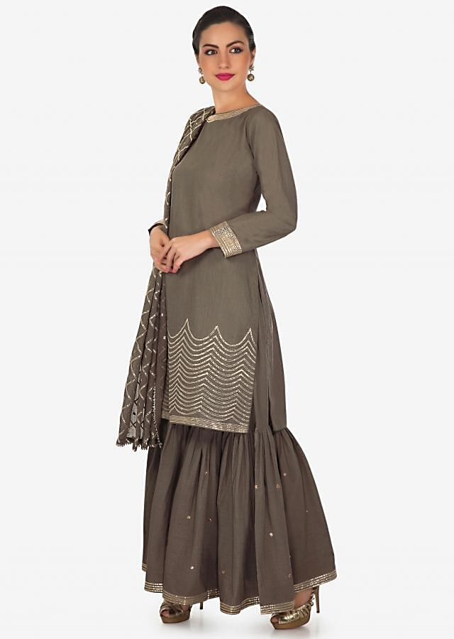 Grey straight suit with sharara pant adorn in gotta lace only on Kalki