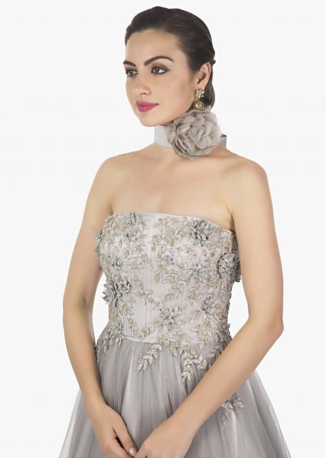 Grey strapless gown in net with 3D flower embroidered bodice only on Kalki