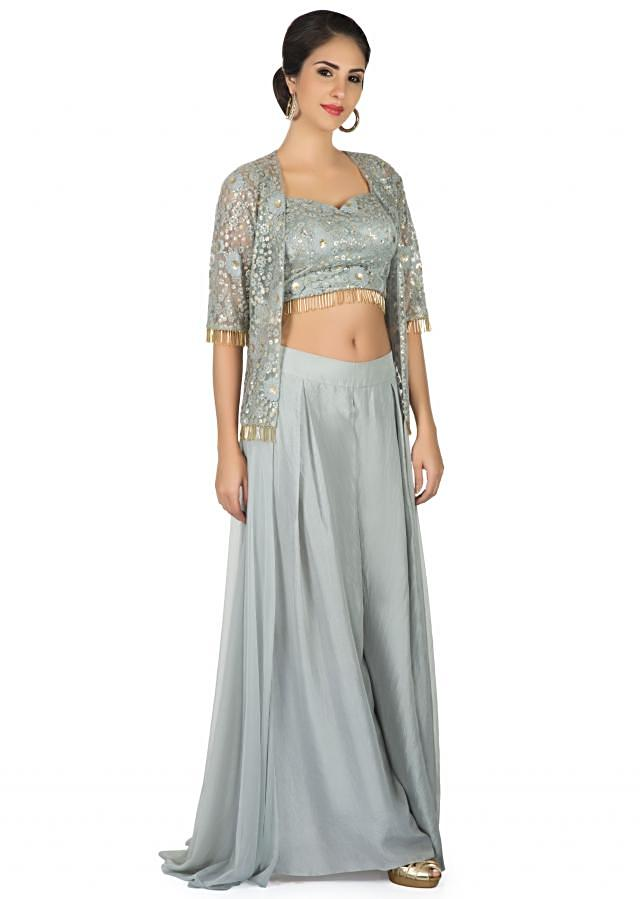 Grey suit in palazzo pant and embroidered jacket with tassel lace only on Kalki