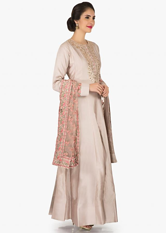 Greyish cream suit in art silk featuring the beautiful gota patch work only on Kalki