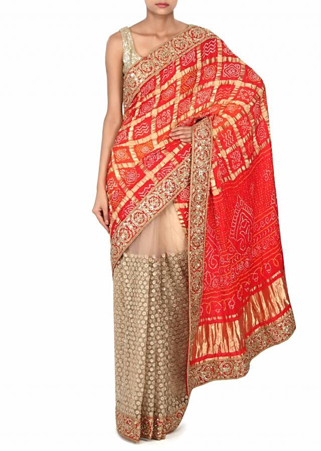 Half and half bandhani saree adorn in zari only on Kalki