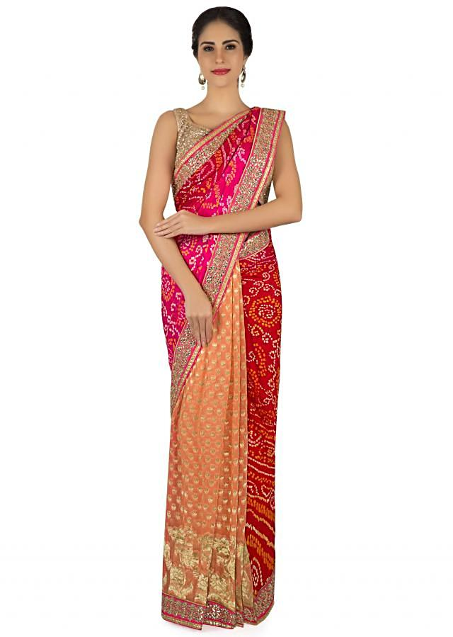 Half and half bandhani saree in red, rani pink and peach only on Kalki