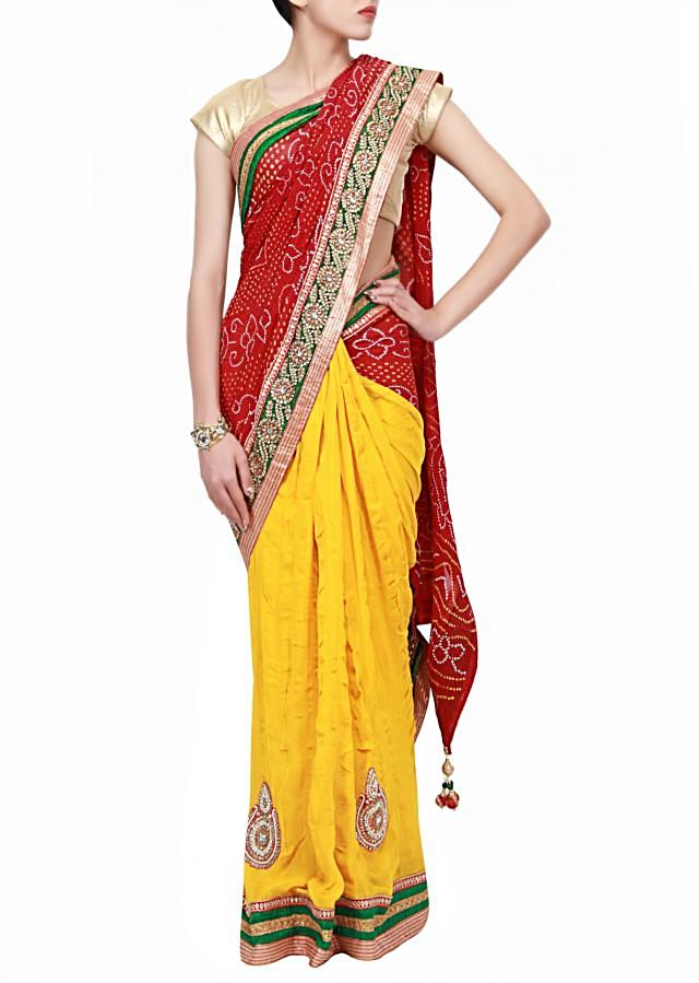 Half and half bandhej saree in red  and yellow embroidered in kundan and pearl only on Kalki