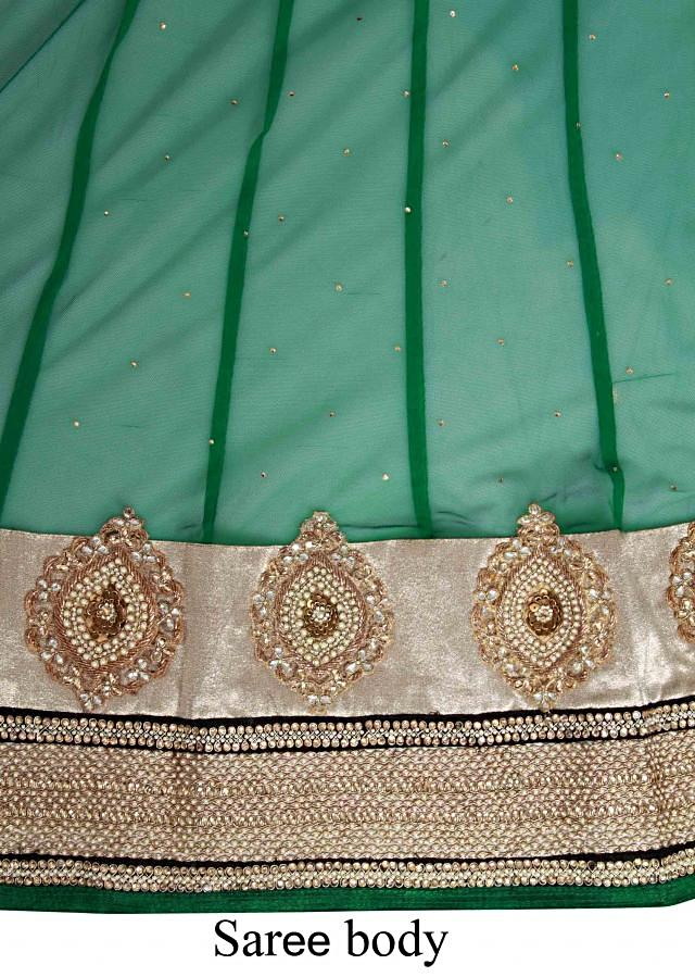 Half and half lehenga saree embellished in red and green stone embroidered butti only on Kalki