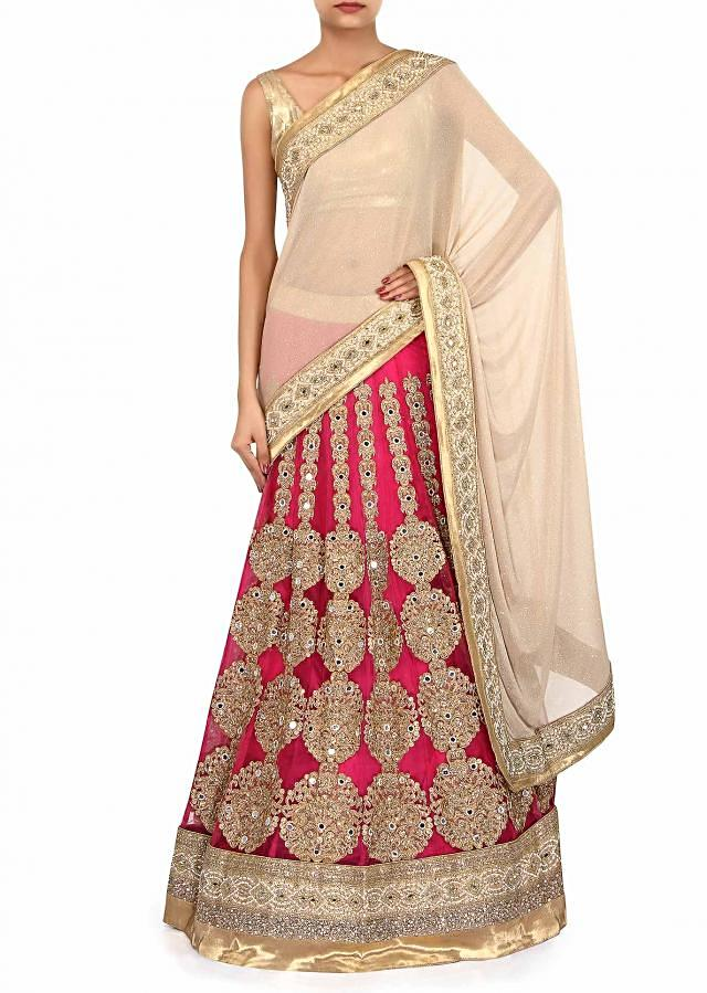 Half and half lehenga saree in gold and pink only on Kalki