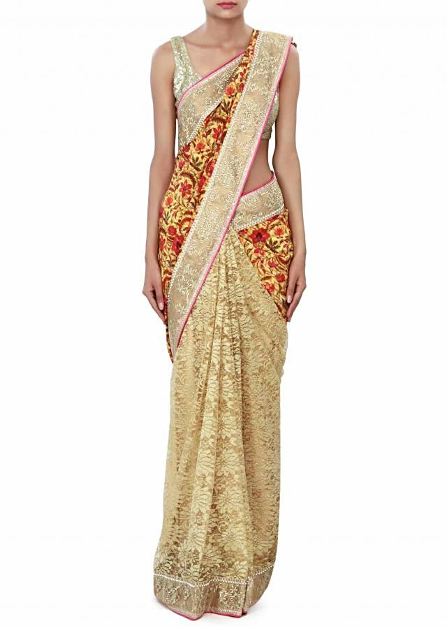 Half and half saree enhanced in print and zari border only on Kalki