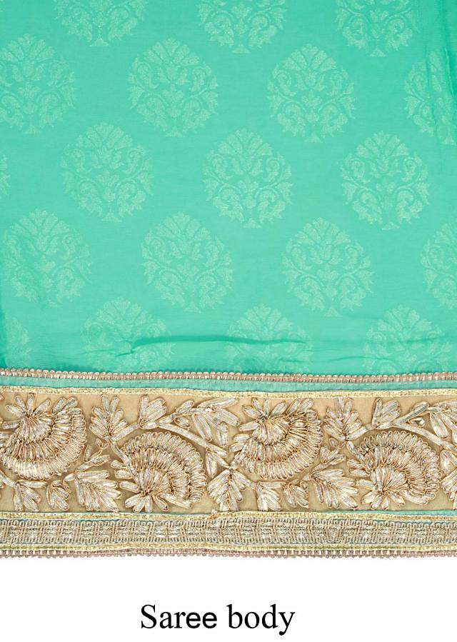 Half and half saree featuring in beige and aruba blue with gotta lace only on Kalki