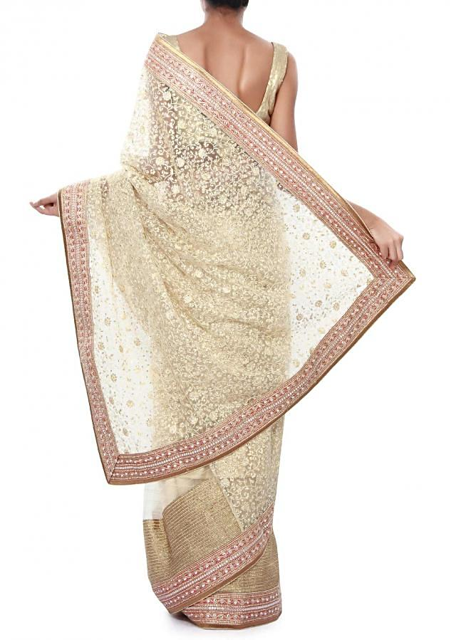 Half and half saree in beige adorn in thread and gotta lace only on Kalki