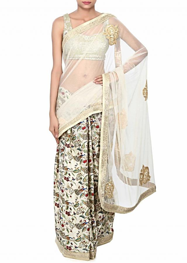 Half and half saree in beige and floral print with floral print only on Kalki