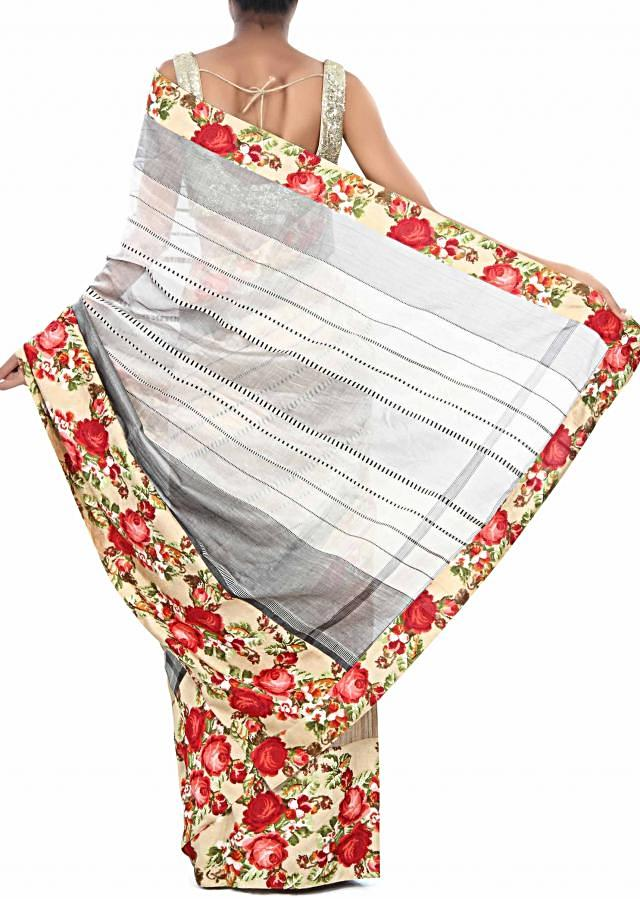 Half and half saree in beige and silk with floral printed border only on Kalki