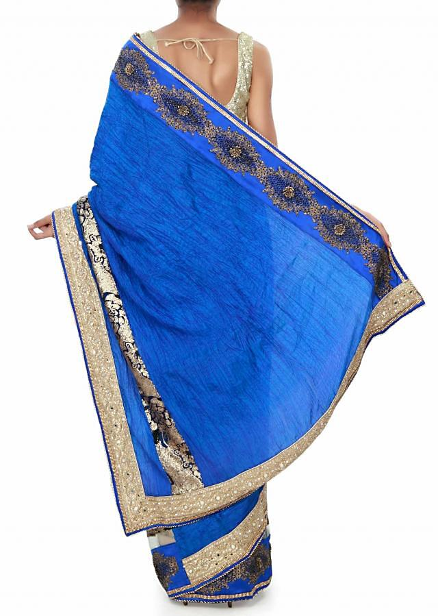 Half and half saree in diva blue and cream adorn in mirror and brocade border only on Kalki