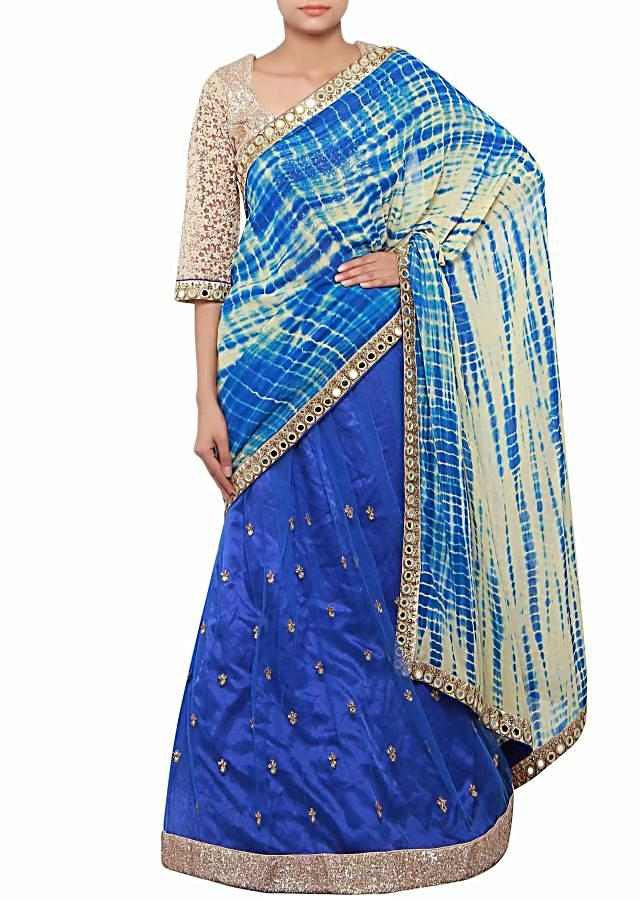 Half and half saree in creamish blue enhanced in sequin and mirror embroidery only on Kalki