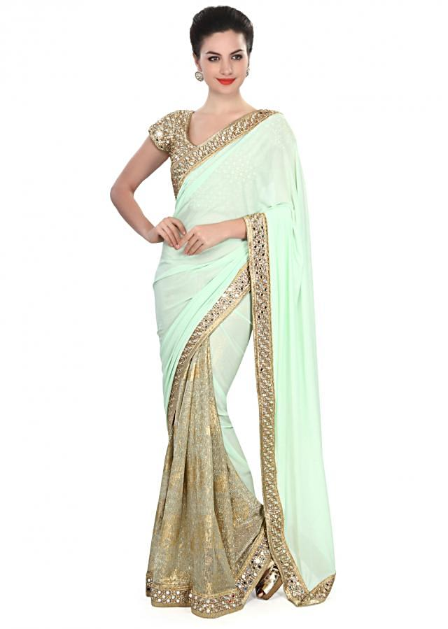 Half and half saree in blue and gold with mirror border only on Kalki