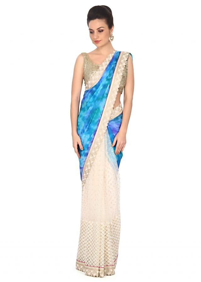 Half and half saree in blue and off white with kundan border only on Kalki