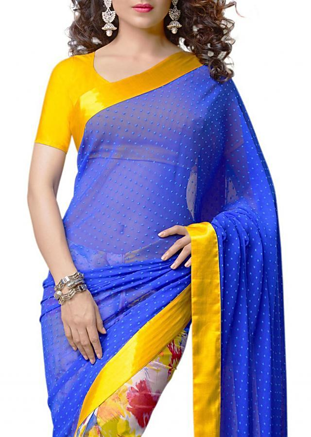 Half and half saree in blue and off white with yellow satin border