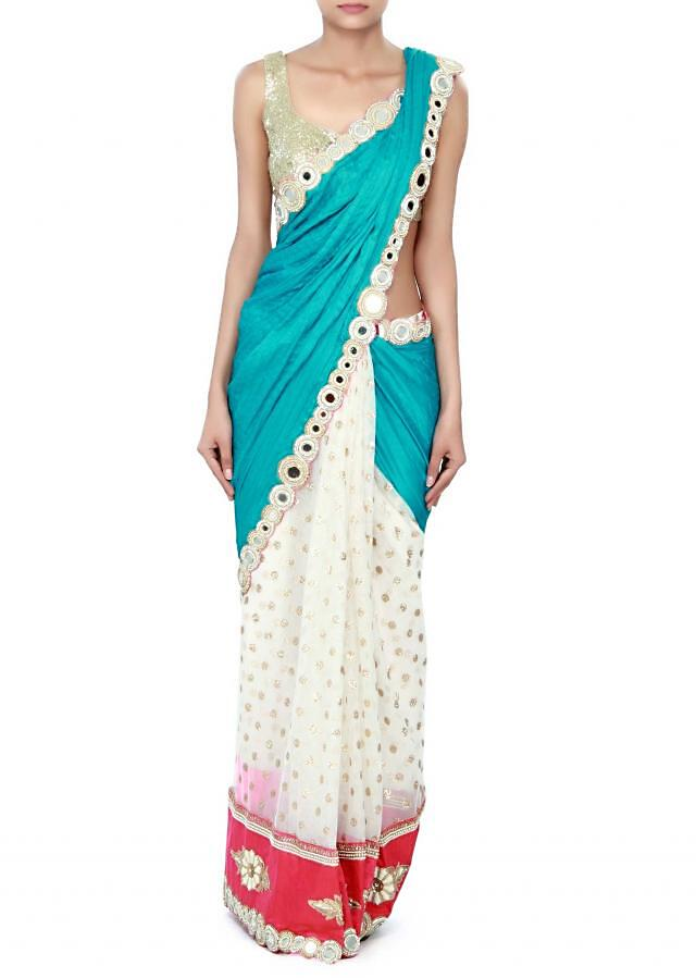 Half and half saree in blue and white with mirror embroidered border only on Kalki