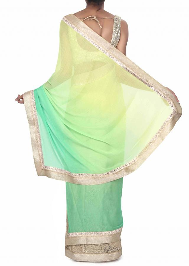 Half and half saree in green adorn in zari embroidery only on Kalki