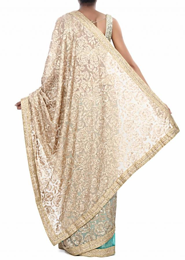 Half and half saree in green and beige adorn in sequin only on Kalki