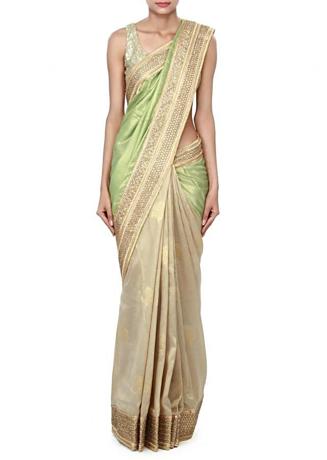 Half and half saree in green and beige with embroidered border only on Kalki