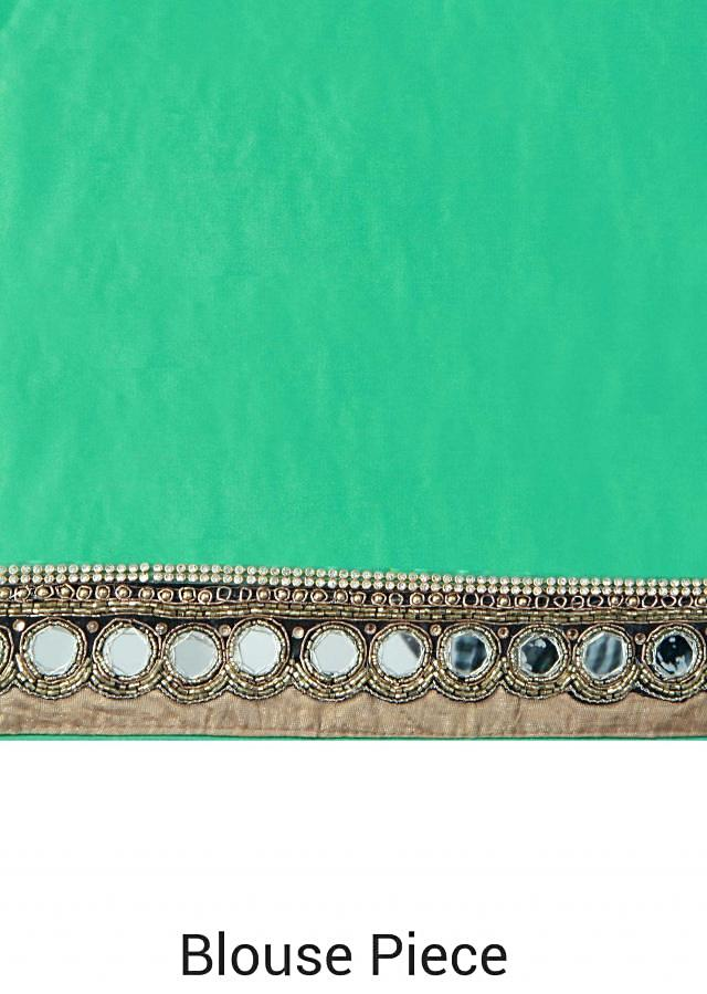 Half and half saree in green and beige with sequin embroidery only on Kalki