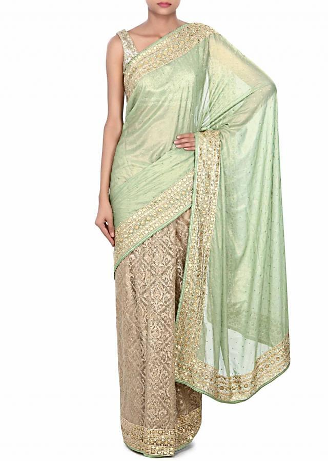 Half and half saree in green and beige with zari and gotta work only on Kalki